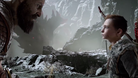 Kratos and his son Atreus in a cave