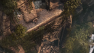 An aerial shot of Lara Croft jumping off of an ancient ruin