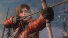 Lara holding a bow and arrow