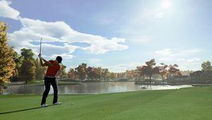 PGA Tour 2K21 screenshot showing golfer swinging in near the lake