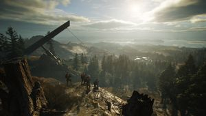 Four players playing co-op in Ghost Recon: Breakpoint, looking out over the map.