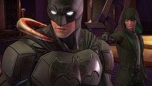The Riddler putting his staff around Batman's neck