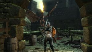 Screenshot from Demon's Souls where the player is standing beneath a stone arch.