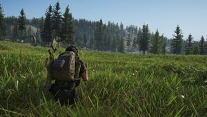 Ghost Recon: Breakpoint screenshot showing a soldier siting in a field