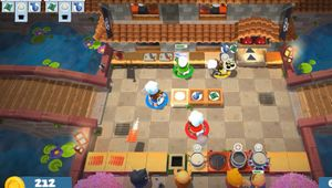 Tiny chefs running around an outdoor kitchen in Overcooked 2