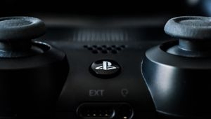 photo showing a close up of black dualshock controller