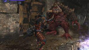 A katana wielding ninja fighting a monster in Onimusha: Warlords