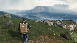 death stranding screenshot showing a man walking towards a lake