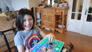 Dyslexia patient playing Zelda and smiling