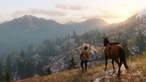 A man with his trusty steed, looking out over the mountains in Red Dead Redemption 2