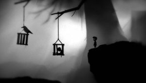Protagonist of noir platformer Limbo looking at hanging cages
