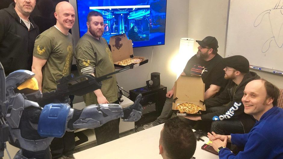 Picture of 343 Industries employees eating pizza