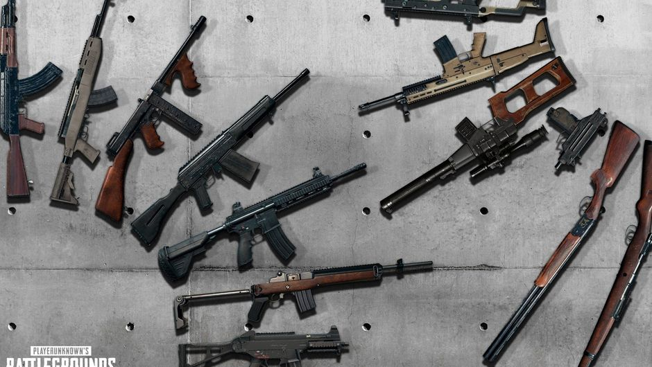 PUBG weapons are placed on a concrete floor, facing each other