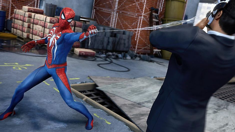 Spider-man slinging a web at a person's face