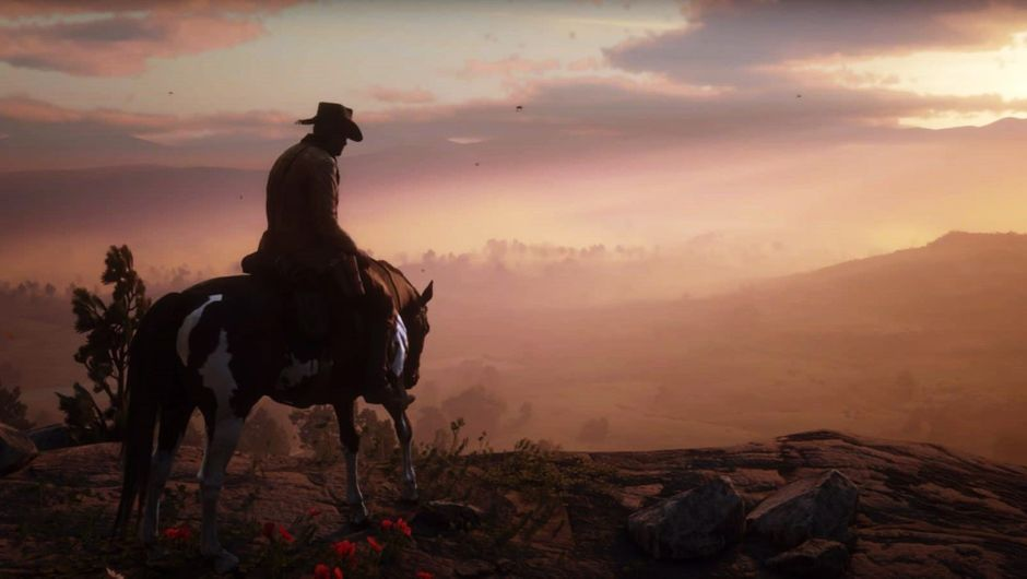 Arthur Morgan riding his horse on top of a hill, overlooking a sunset.