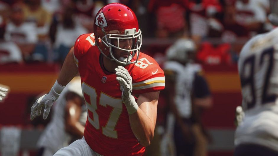 A screenshot of Travis Kelce wearing his home uniform in Madden NFL 19.