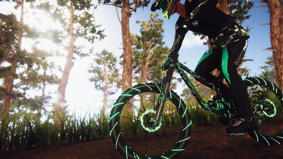 A cyclist from Descenders on a dirt track