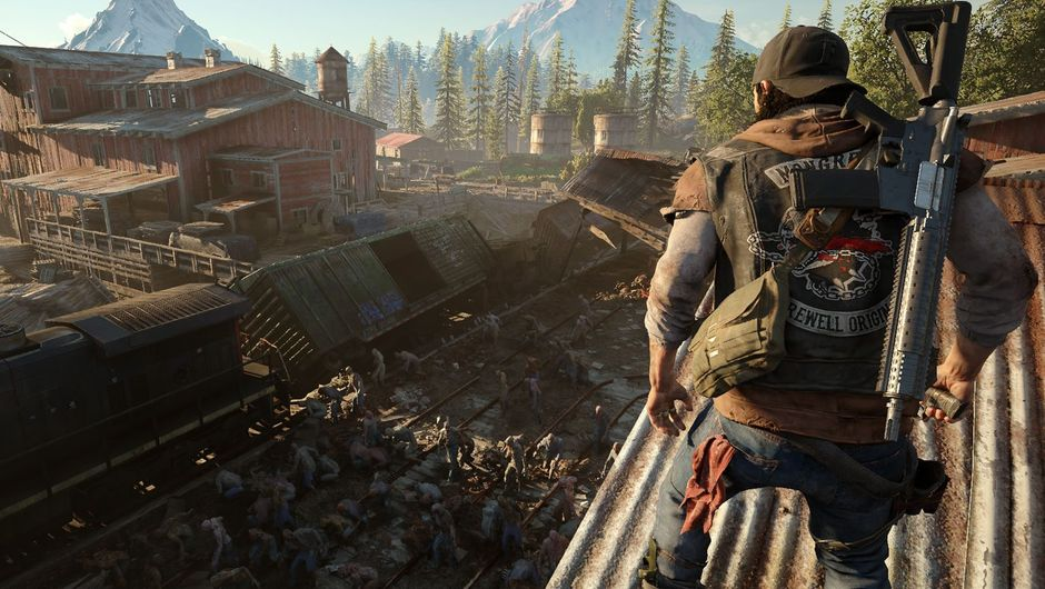 Days Gone protagonist looking at a derelict train-yard