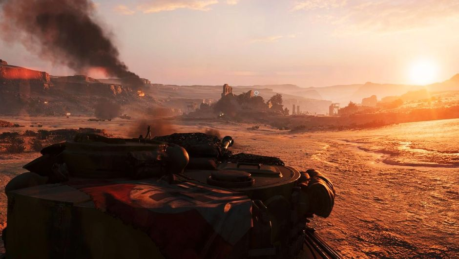 Battlefield 5 screenshot of a tank taking aim in a sandy desert afternoon