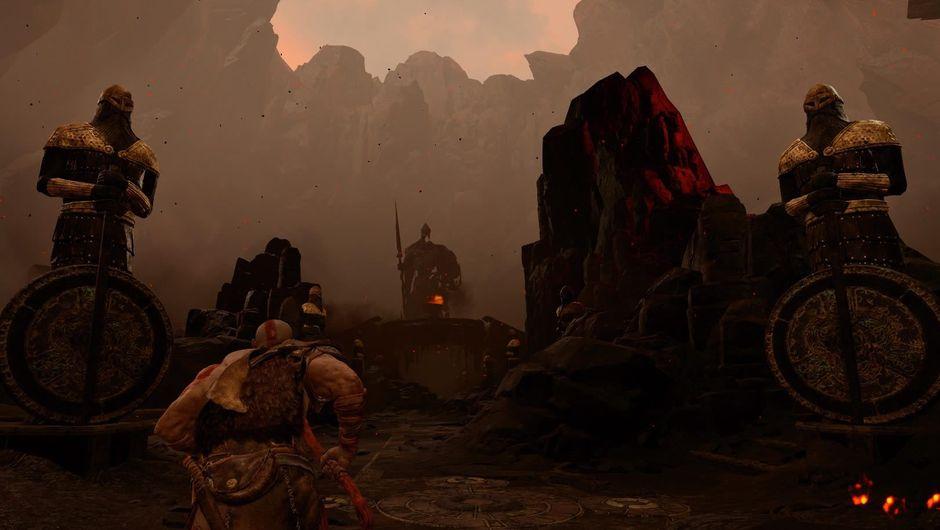 Kratos from the 2018 God of War running towards a man