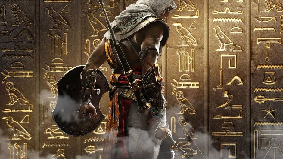 Bayek standing in front of hieroglyphs