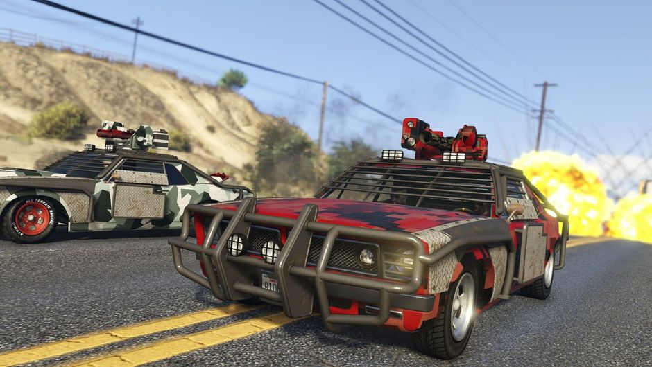 Screenshot from GTA V showing two heavily armoured cars racing on a highway.