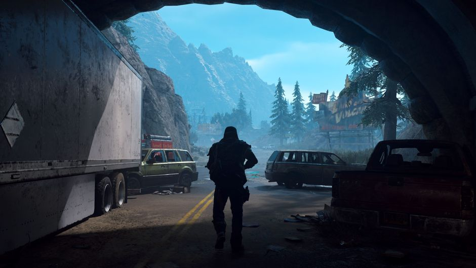 Days Gone protagonist walking out of a dark tunnel