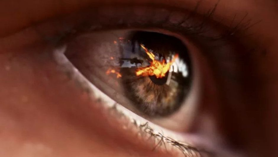 picture showing soldier's eye with a explosion reflection