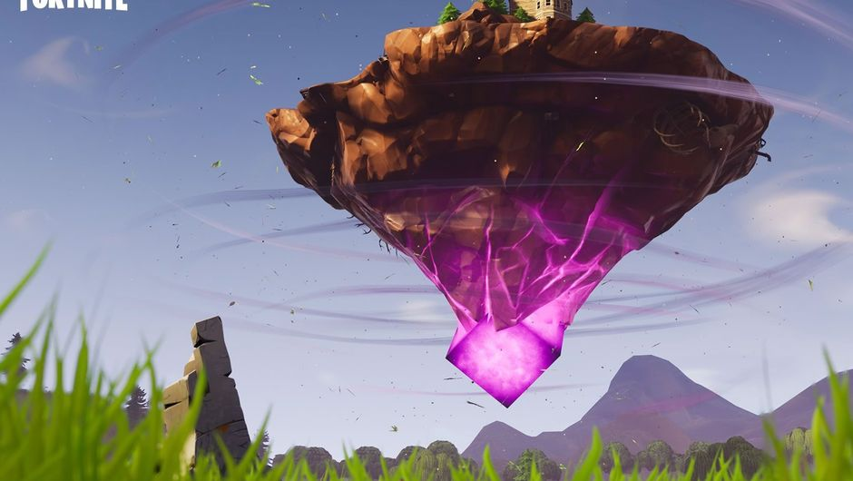 A glowing cube propping up an island in the air from Fortnite