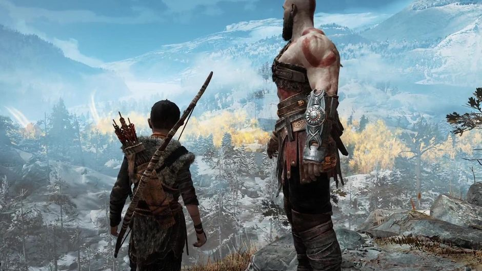 Kratos and Atreus standing on top of a mountain.