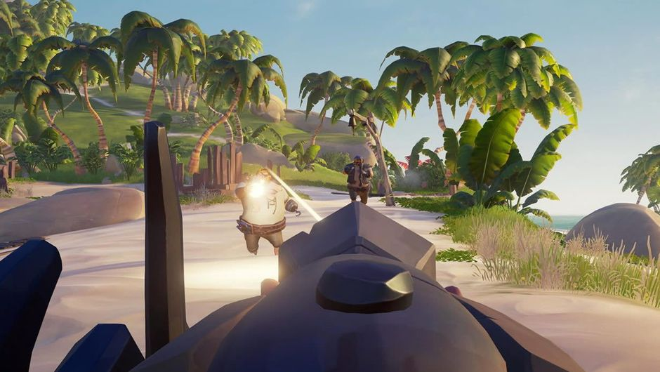 A cannon turned towards few characters from the game Sea of Thieves