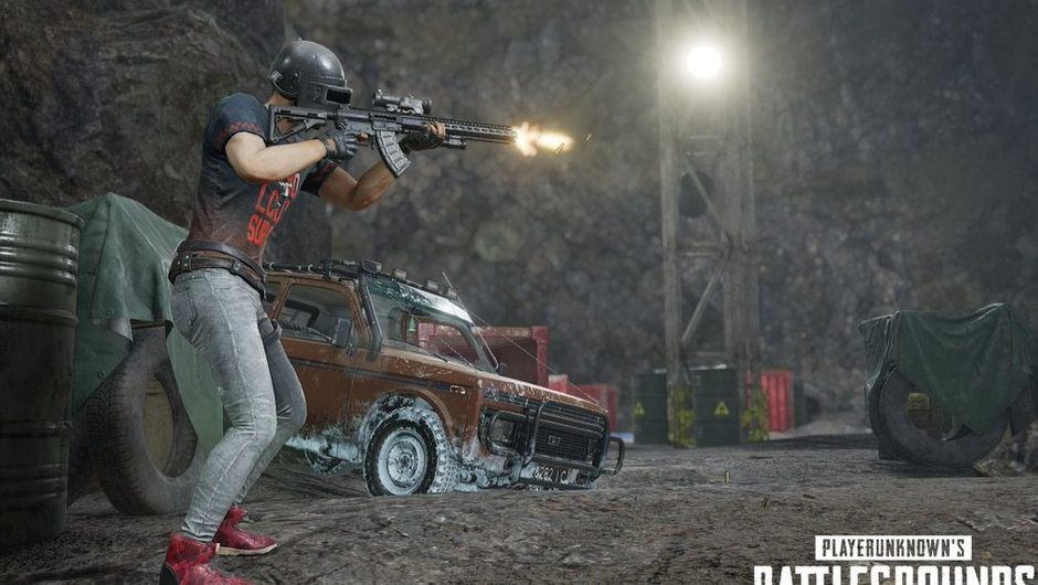 pubg screenshot showing a character inside the cave, shooting from assault rifle