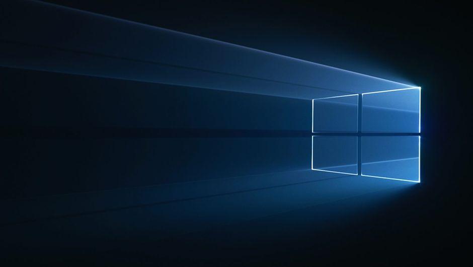 Windows 10 logo on a dark background.
