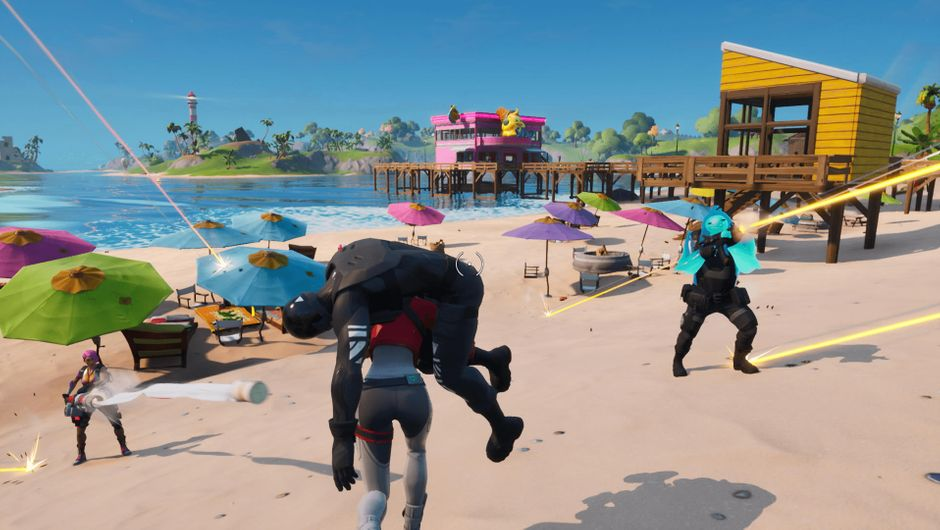 Fortnite character carrying another character across a beach