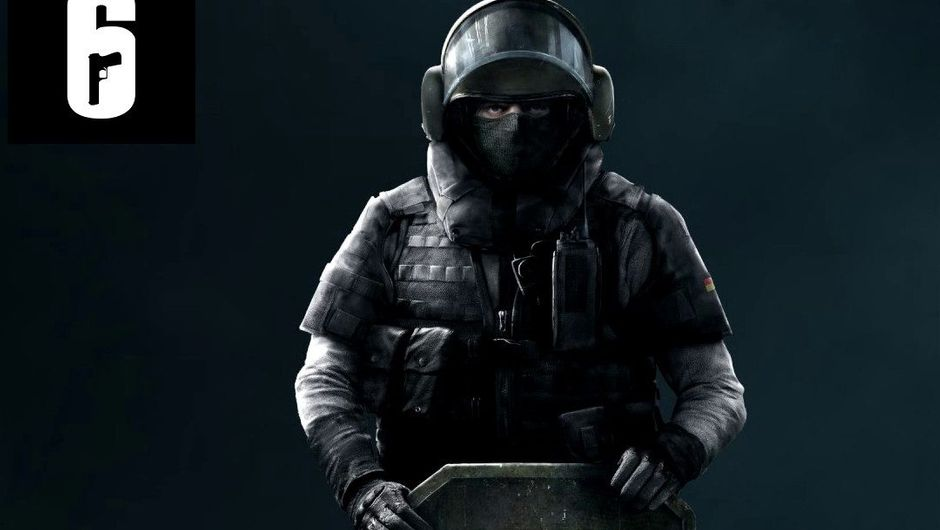 Rainbow operator Blitz is posing for a picture with his shield.