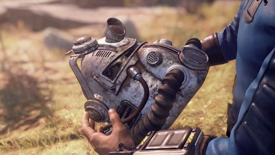 Picture of a vault dweller holding a T-51b helmet