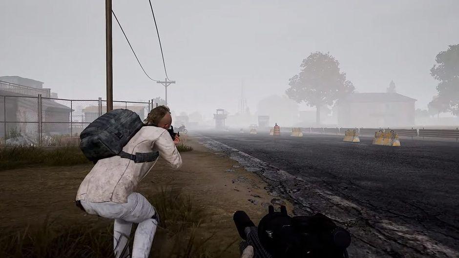 PUBG screenshot showing a character in white suit aiming a gun