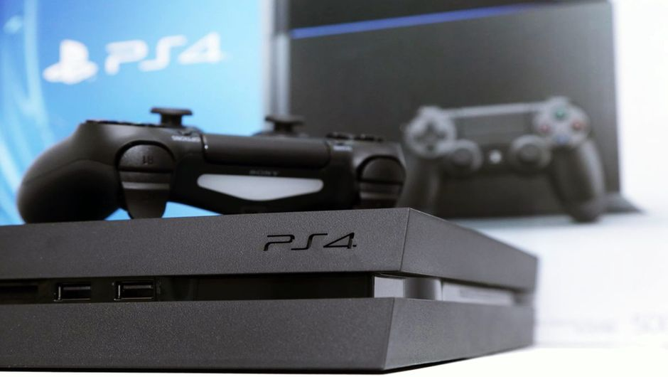PlayStation 4 with a DualShock 4 on top.