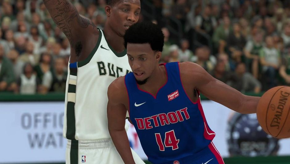 Ish Smith of Detroit Pistons guarded by a Bucks defender