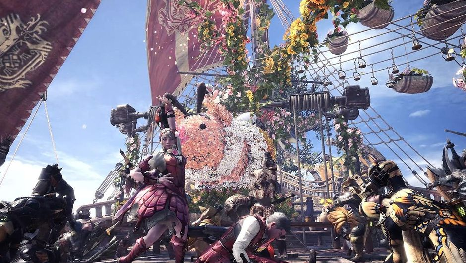 monster hunter world showing several characters celebrating at the gathering hub
