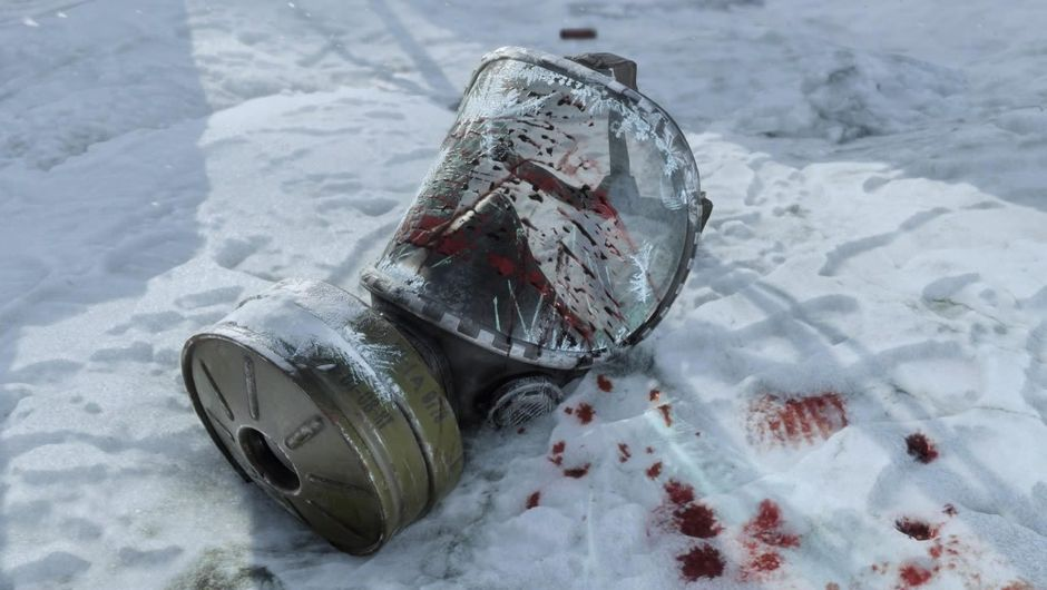 A bloodied and broken gas mask lying in blood-stained snow