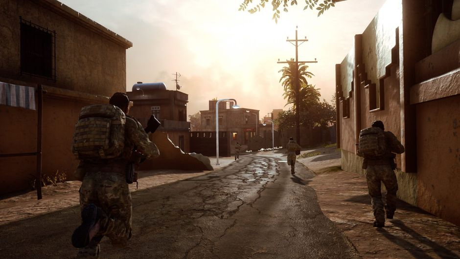 Soldiers running through an alley in a deserted town.