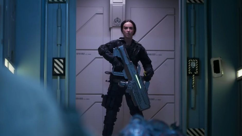 Doom: Annihilation shot showing a female character holding big weapon
