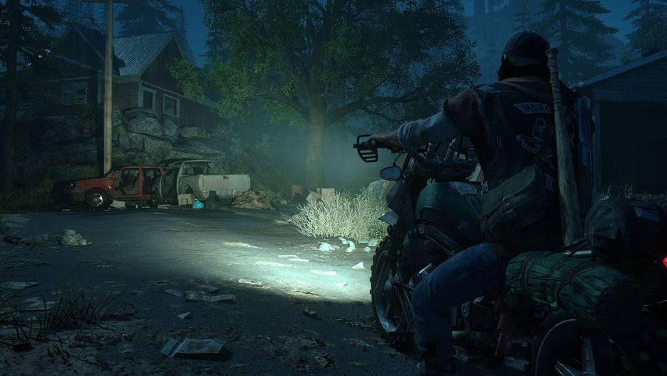 Days Gone protagonist pointing a headlight on an old house at night