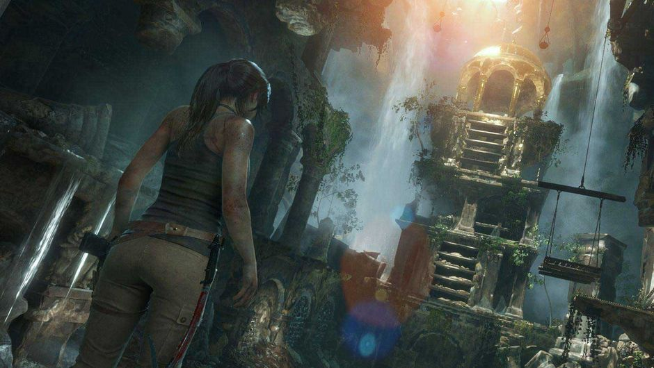 Lara Croft is standing in some temple taking in the sights.