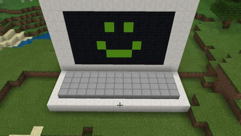 A computer with a smiley face built in Minecraft