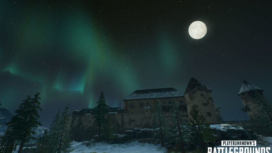 picture showing northern lights over a castle