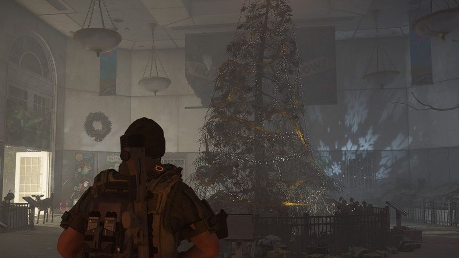 Picture of an SHD agent standing in front of a Christmas tree