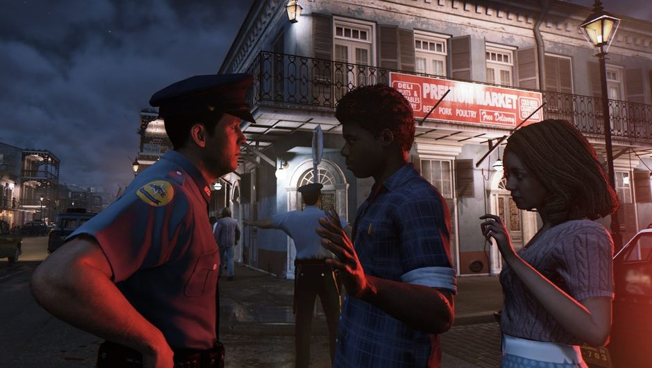 Picture of a police officer questioning two people on the street