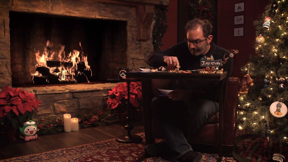 Jeff Kaplan putting Lego Junkertown together in front of a fireplace
